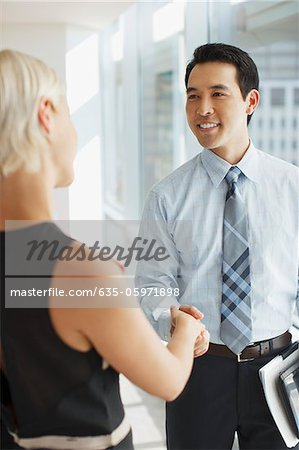 Business people shaking hands in office Stock Photo - Premium Royalty-Free, Image code: 635-05971898
