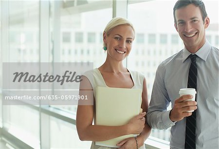 Smiling business people standing in office Stock Photo - Premium Royalty-Free, Image code: 635-05971901