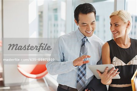 Business people using tablet computer in office Stock Photo - Premium Royalty-Free, Image code: 635-05971910