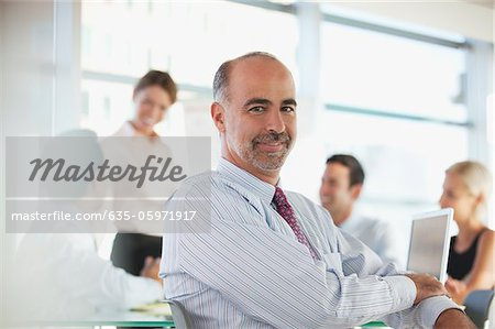 Businessman sitting in meeting Stock Photo - Premium Royalty-Free, Image code: 635-05971917