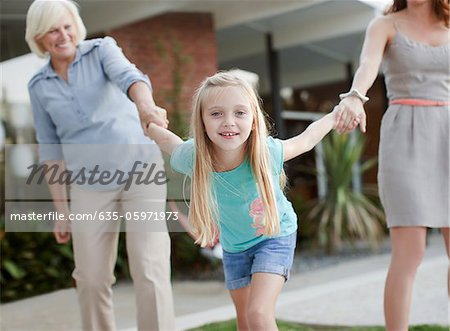 Three generations of women holding hands Stock Photo - Premium Royalty-Free, Image code: 635-05971973