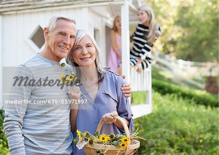 Older couple picking flowers outdoors Stock Photo - Premium Royalty-Free, Image code: 635-05971997