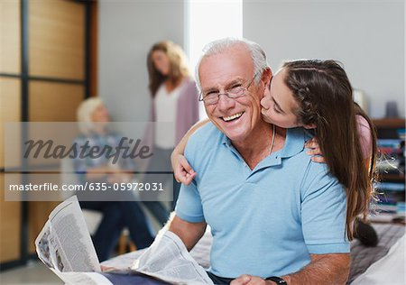 Girl kissing grandfather in home Stock Photo - Premium Royalty-Free, Image code: 635-05972031