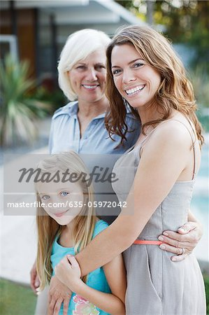Three generations of women smiling together Stock Photo - Premium Royalty-Free, Image code: 635-05972042