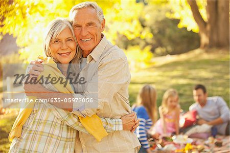 Older couple hugging outdoors Stock Photo - Premium Royalty-Free, Image code: 635-05972056