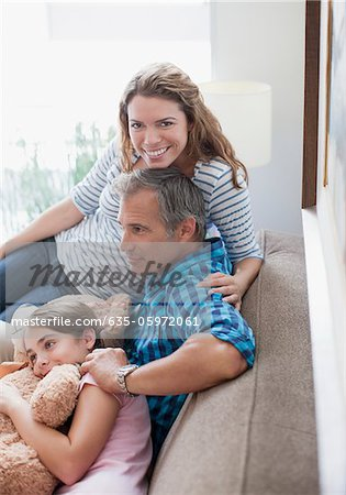 Family relaxing on sofa together Stock Photo - Premium Royalty-Free, Image code: 635-05972061