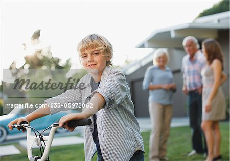 Boy riding bicycle outdoors Stock Photo - Premium Royalty-Free, Image code: 635-05972062