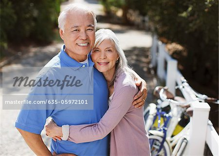 Smiling older couple relaxing outdoors Stock Photo - Premium Royalty-Free, Image code: 635-05972101