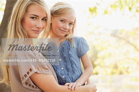 Mother holding daughter outdoors Stock Photo - Premium Royalty-Free, Image code: 635-05972110