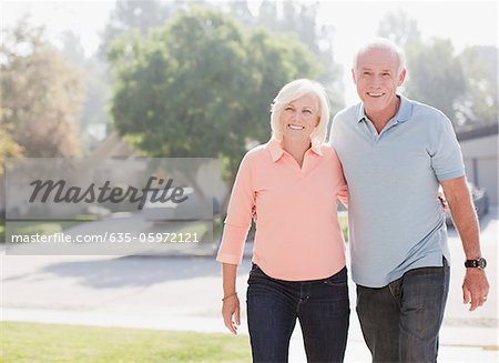 Smiling older couple walking together Stock Photo - Premium Royalty-Free, Image code: 635-05972121