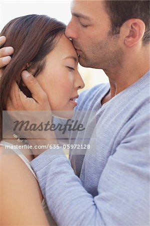 Couple kissing outdoors Stock Photo - Premium Royalty-Free, Image code: 635-05972128