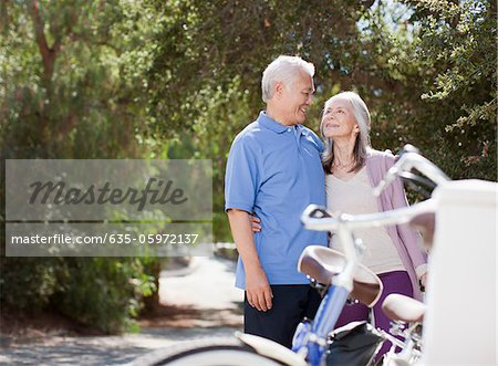 Smiling older couple hugging outdoors Stock Photo - Premium Royalty-Free, Image code: 635-05972137