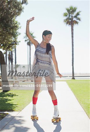 Smiling woman skating in park Stock Photo - Premium Royalty-Free, Image code: 635-05972199