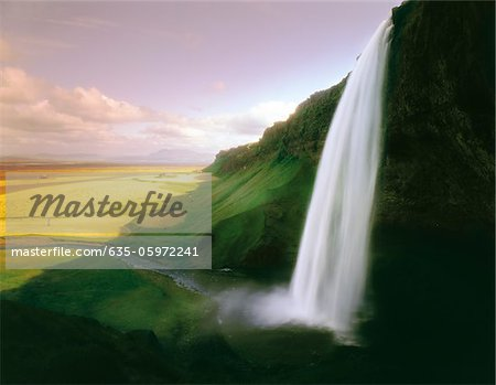 Time lapse view of waterfall over cliff Stock Photo - Premium Royalty-Free, Image code: 635-05972241