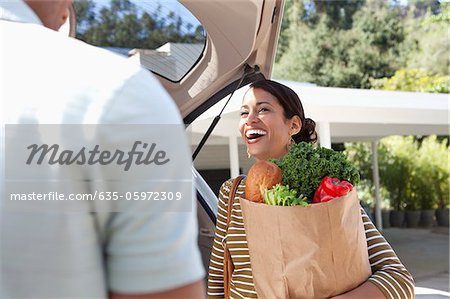 Woman unloading groceries from car Stock Photo - Premium Royalty-Free, Image code: 635-05972309