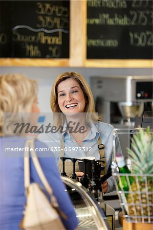 Server in supermarket talking with customer Stock Photo - Premium Royalty-Free, Image code: 635-05972312