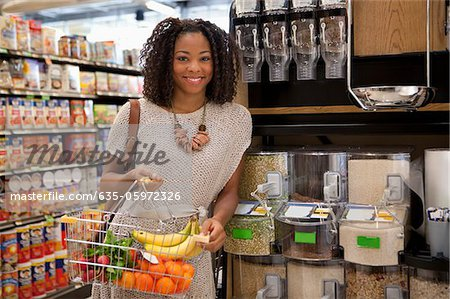 Woman shopping in supermarket Stock Photo - Premium Royalty-Free, Image code: 635-05972326