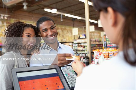Couple buying groceries in supermarket Stock Photo - Premium Royalty-Free, Image code: 635-05972375
