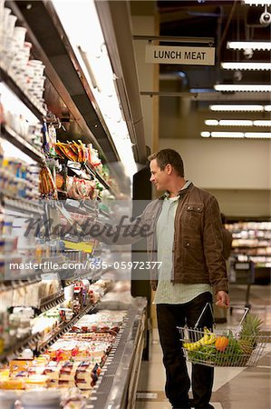 Man shopping in supermarket Stock Photo - Premium Royalty-Free, Image code: 635-05972377