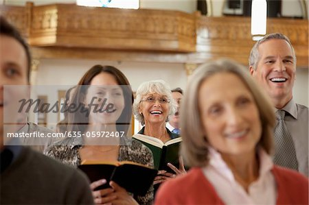 Congregation singing together in church Stock Photo - Premium Royalty-Free, Image code: 635-05972407