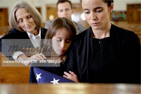 Mother and daughter at military funeral Stock Photo - Premium Royalty-Free, Image code: 635-05972502