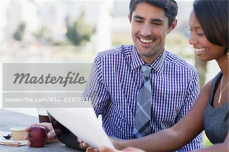 Business people working in park Stock Photo - Premium Royalty-Free, Image code: 635-05972531