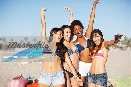 Women taking picture of themselves on beach Stock Photo - Premium Royalty-Free, Image code: 635-05972603