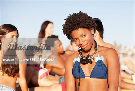 Woman wearing headphones on beach Stock Photo - Premium Royalty-Free, Image code: 635-05972642