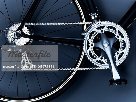 Close up of bicycle chain, pedal and gears Stock Photo - Premium Royalty-Free, Image code: 635-05972686