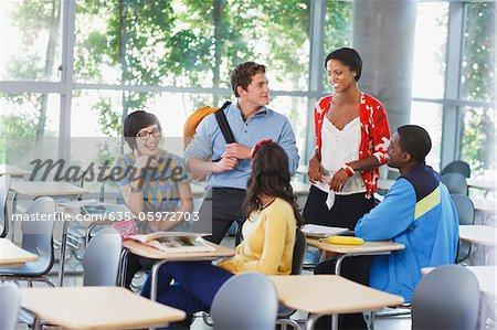 Students talking in classroom Stock Photo - Premium Royalty-Free, Image code: 635-05972703