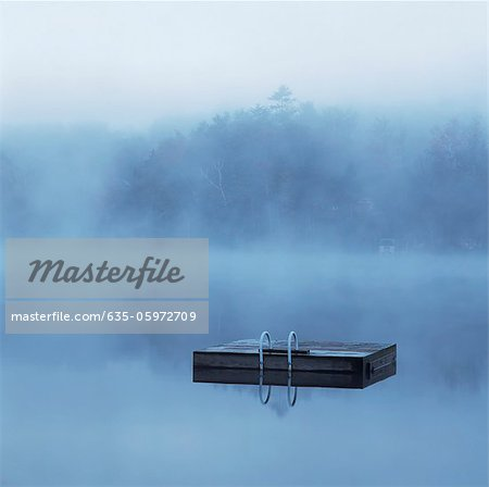 Wooden dock floating in still lake Stock Photo - Premium Royalty-Free, Image code: 635-05972709