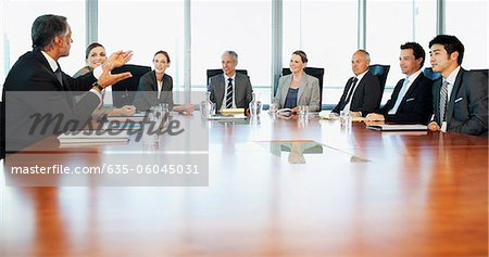 Business people meeting at table in conference room Stock Photo - Premium Royalty-Free, Image code: 635-06045031