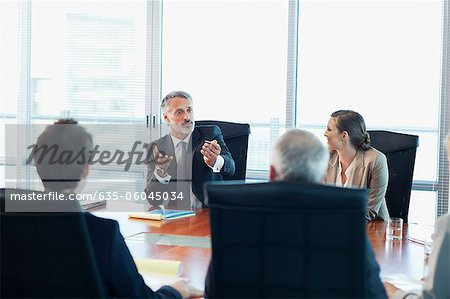 Business people meeting at table in conference room Stock Photo - Premium Royalty-Free, Image code: 635-06045034