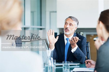 Gesturing businessman leading meeting in conference room Stock Photo - Premium Royalty-Free, Image code: 635-06045038