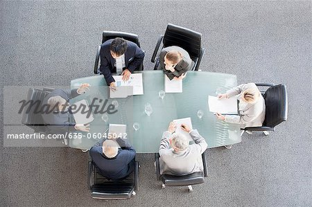 Business people meeting at table in conference room Stock Photo - Premium Royalty-Free, Image code: 635-06045042