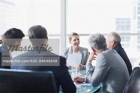 Smiling businesswoman leading meeting in conference room Stock Photo - Premium Royalty-Free, Image code: 635-06045048