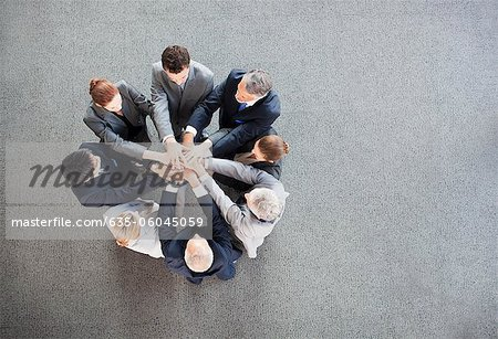 Business people stacking hands in circle Stock Photo - Premium Royalty-Free, Image code: 635-06045059