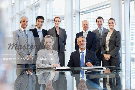 Portrait of smiling business people in conference room Stock Photo - Premium Royalty-Free, Image code: 635-06045061