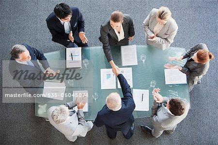 Business people shaking hands across conference room table Stock Photo - Premium Royalty-Free, Image code: 635-06045074