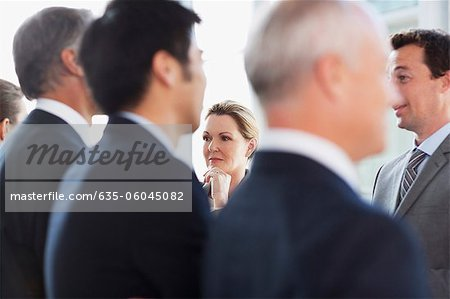 Business people talking face to face Stock Photo - Premium Royalty-Free, Image code: 635-06045082