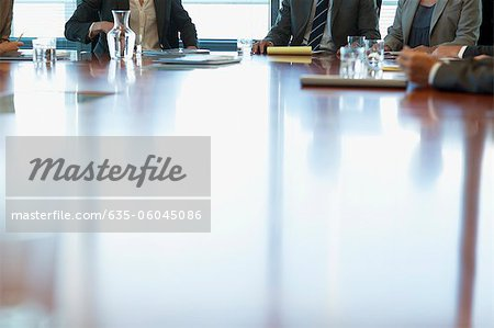 Business people meeting at table in conference room Stock Photo - Premium Royalty-Free, Image code: 635-06045086