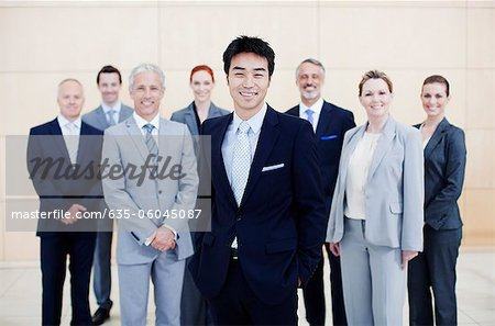 Portrait of smiling business people Stock Photo - Premium Royalty-Free, Image code: 635-06045087