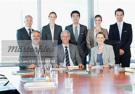 Portrait of smiling business people in conference room Stock Photo - Premium Royalty-Free, Image code: 635-06045098