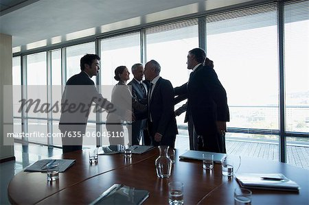 Business people shaking hands in conference room Stock Photo - Premium Royalty-Free, Image code: 635-06045110