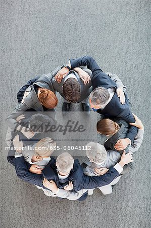 Business people in huddle Stock Photo - Premium Royalty-Free, Image code: 635-06045112