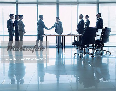 Business people shaking hands in conference room Stock Photo - Premium Royalty-Free, Image code: 635-06045115