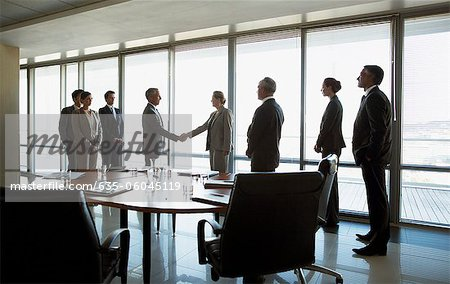 Business people shaking hands in conference room Stock Photo - Premium Royalty-Free, Image code: 635-06045119