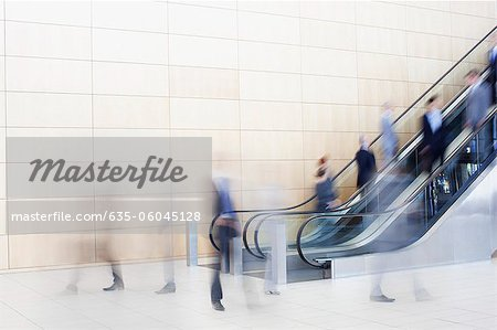 Business people on escalators Stock Photo - Premium Royalty-Free, Image code: 635-06045128