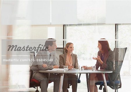 Business people talking at table in conference room Stock Photo - Premium Royalty-Free, Image code: 635-06045140