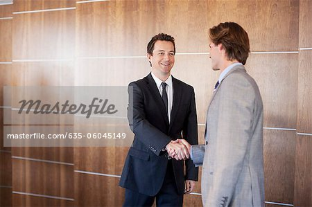 Smiling businessmen shaking hands Stock Photo - Premium Royalty-Free, Image code: 635-06045149
